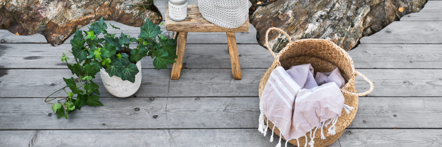 Heartwood decking, pot with plant and basket with blanket