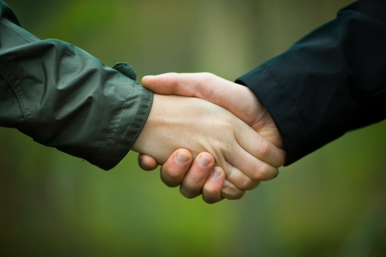 Handshake. Handslag.